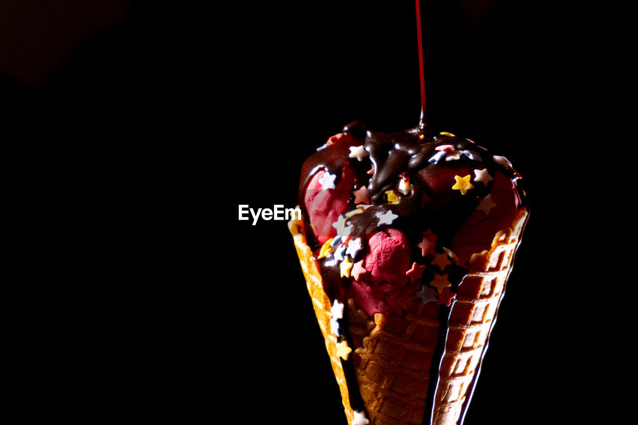 sweet food, sweet, unhealthy eating, indulgence, food and drink, food, studio shot, dessert, temptation, copy space, ice cream, indoors, close-up, dairy product, black background, freshness, ready-to-eat, sprinkles, frozen food, no people