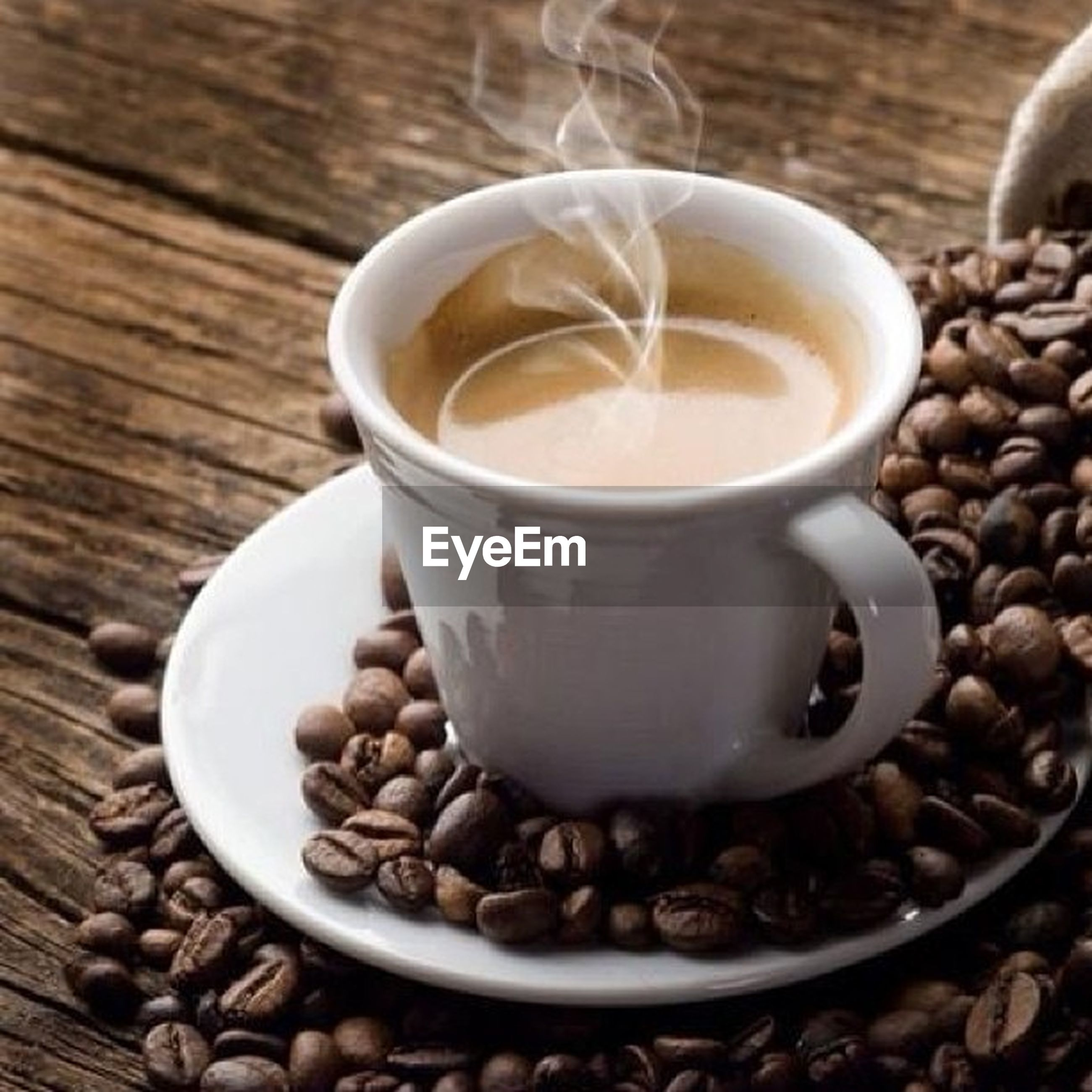 food and drink, drink, refreshment, coffee - drink, coffee cup, freshness, saucer, table, indoors, still life, frothy drink, close-up, coffee, cup, cappuccino, healthy eating, spoon, high angle view, wood - material, selective focus