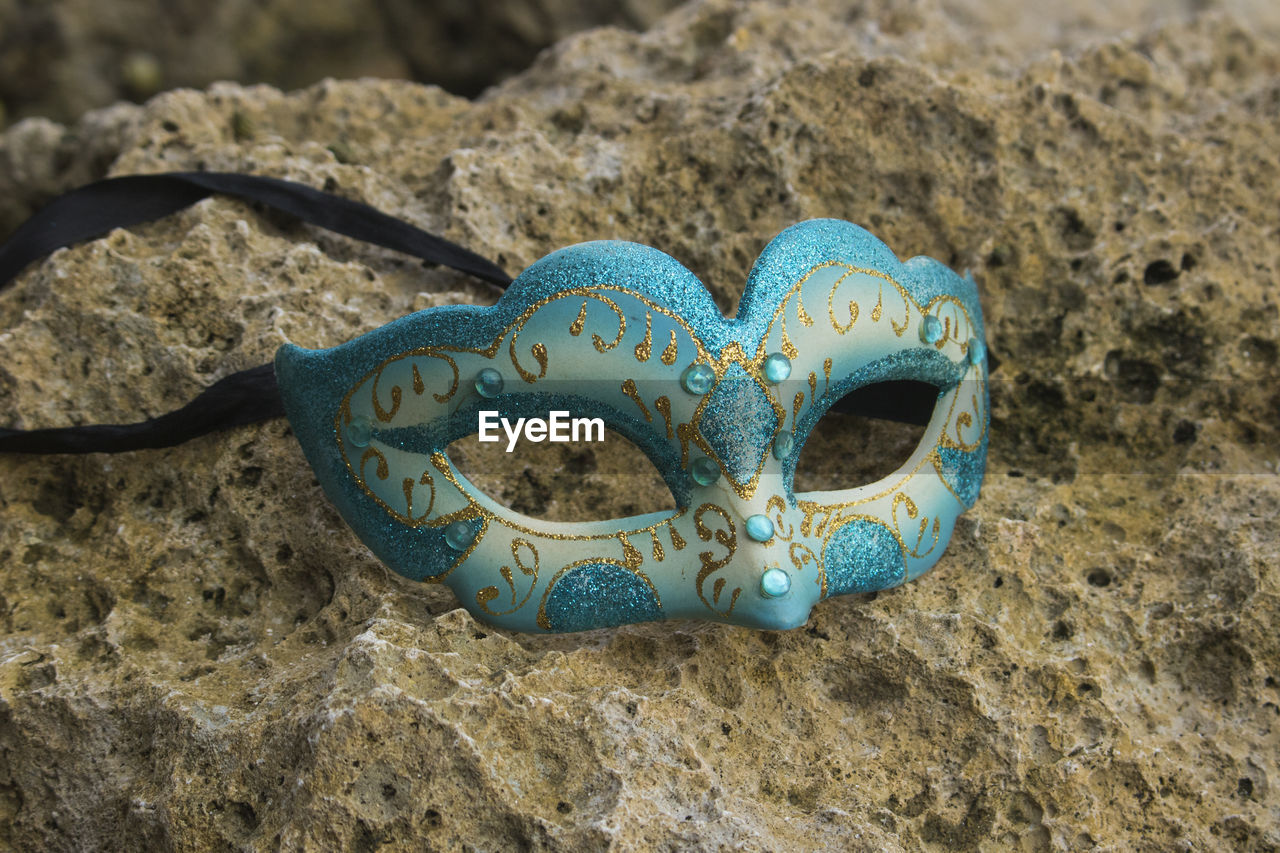 close-up, no people, high angle view, land, day, sand, beach, still life, nature, blue, rock - object, rock, focus on foreground, disguise, creativity, mask - disguise, mask, outdoors, solid, eye mask