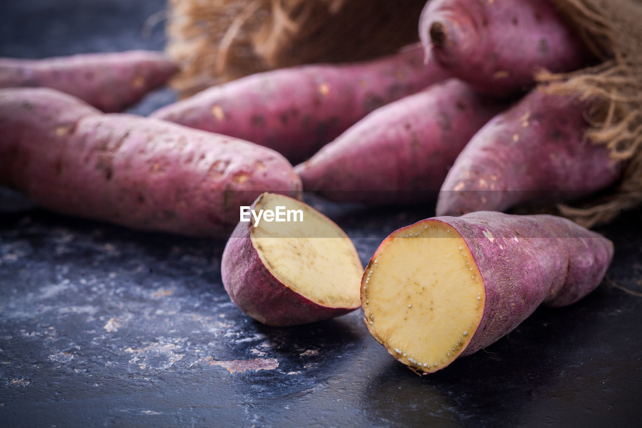 food and drink, food, healthy eating, freshness, wellbeing, still life, table, raw food, close-up, no people, vegetable, root vegetable, indoors, potato, day, focus on foreground, sweet potato, group of objects, purple, selective focus, common beet