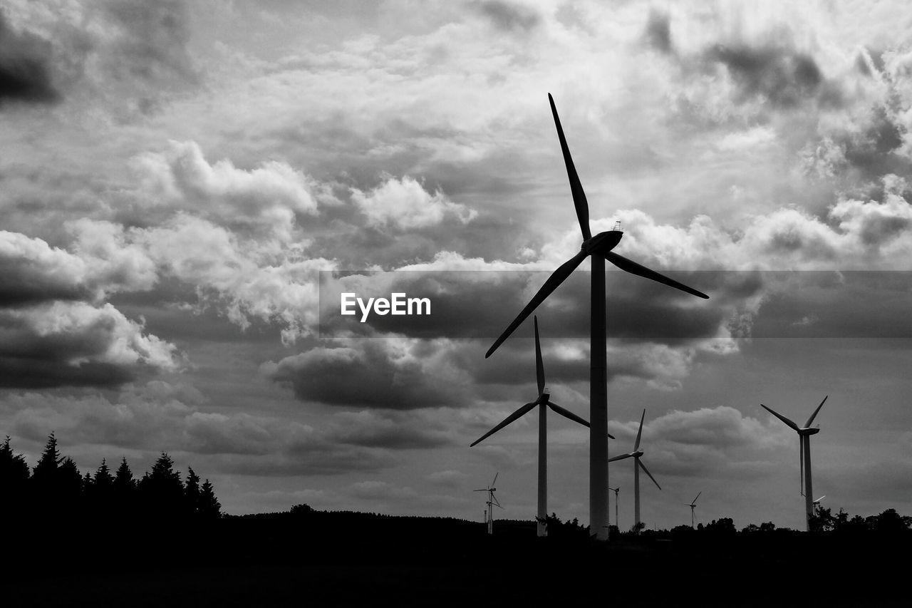 environmental conservation, alternative energy, wind turbine, wind power, fuel and power generation, renewable energy, windmill, industrial windmill, sky, cloud - sky, rural scene, outdoors, field, nature, low angle view, traditional windmill, silhouette, no people, day, technology, tree, beauty in nature