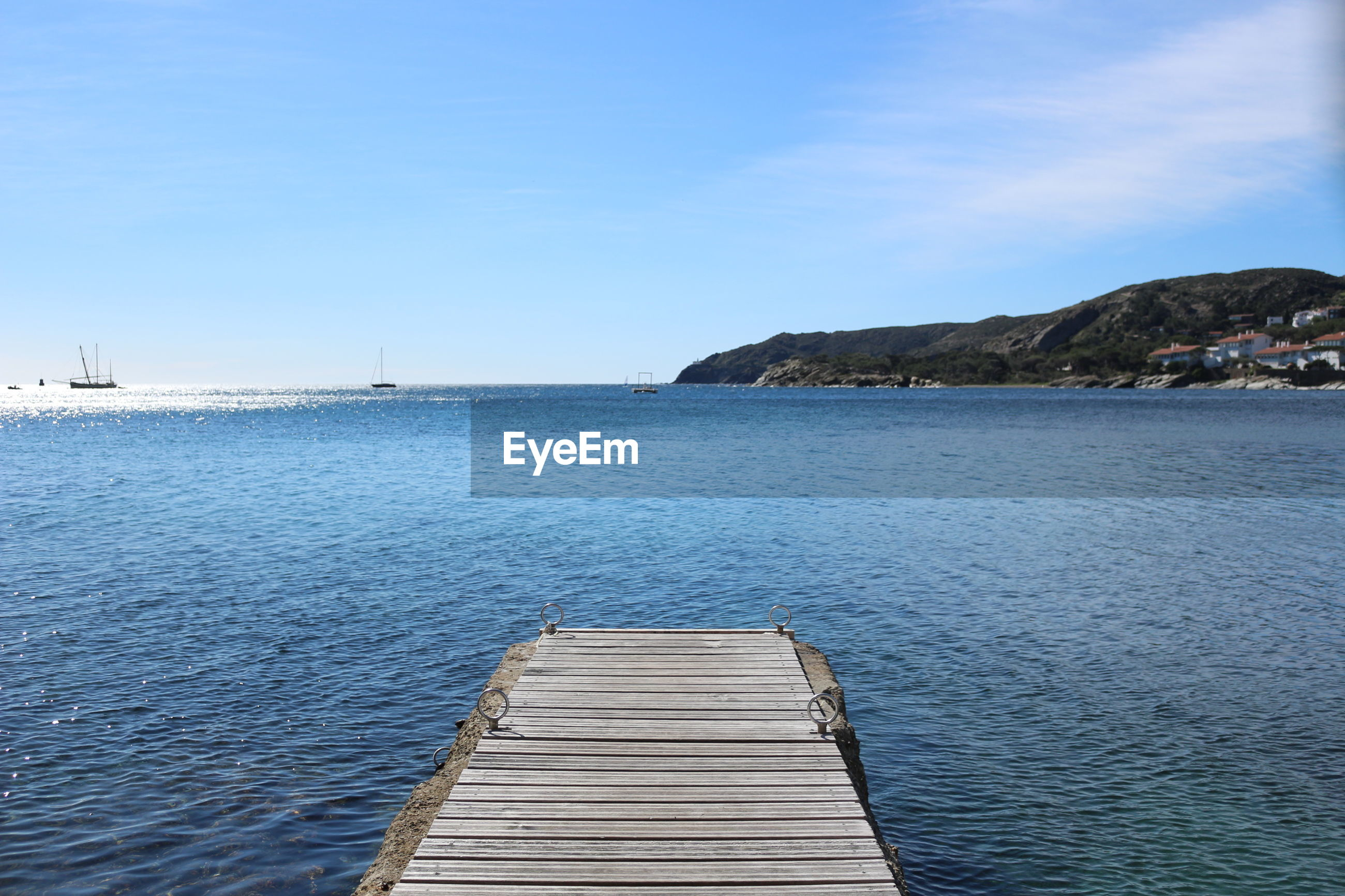 Scenic view of calm sea against blue sky