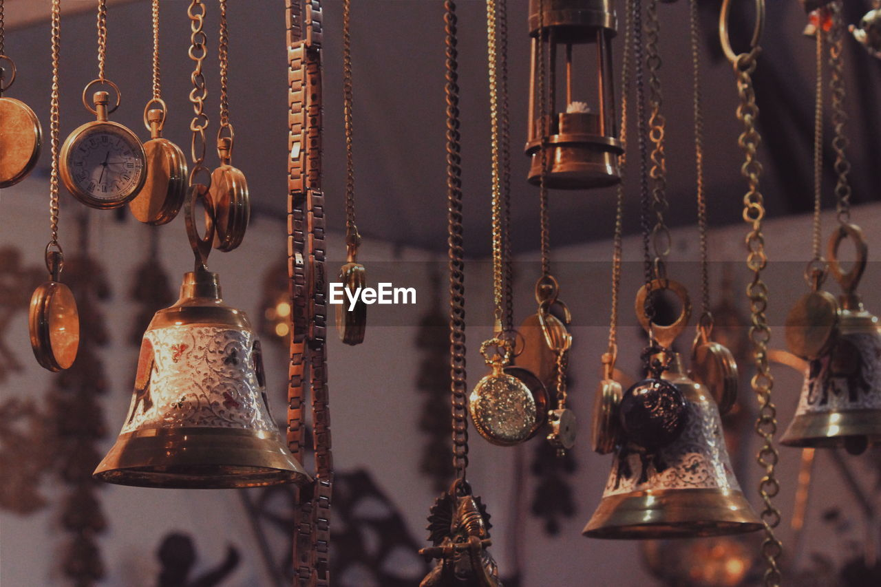 Bells With Pocket Watches Hanging In Market For Sale