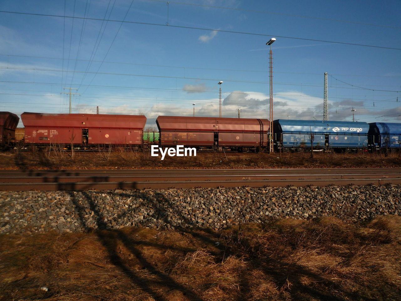 transportation, railroad track, rail transportation, sky, cable, train - vehicle, no people, day, outdoors, landscape, electricity pylon, nature