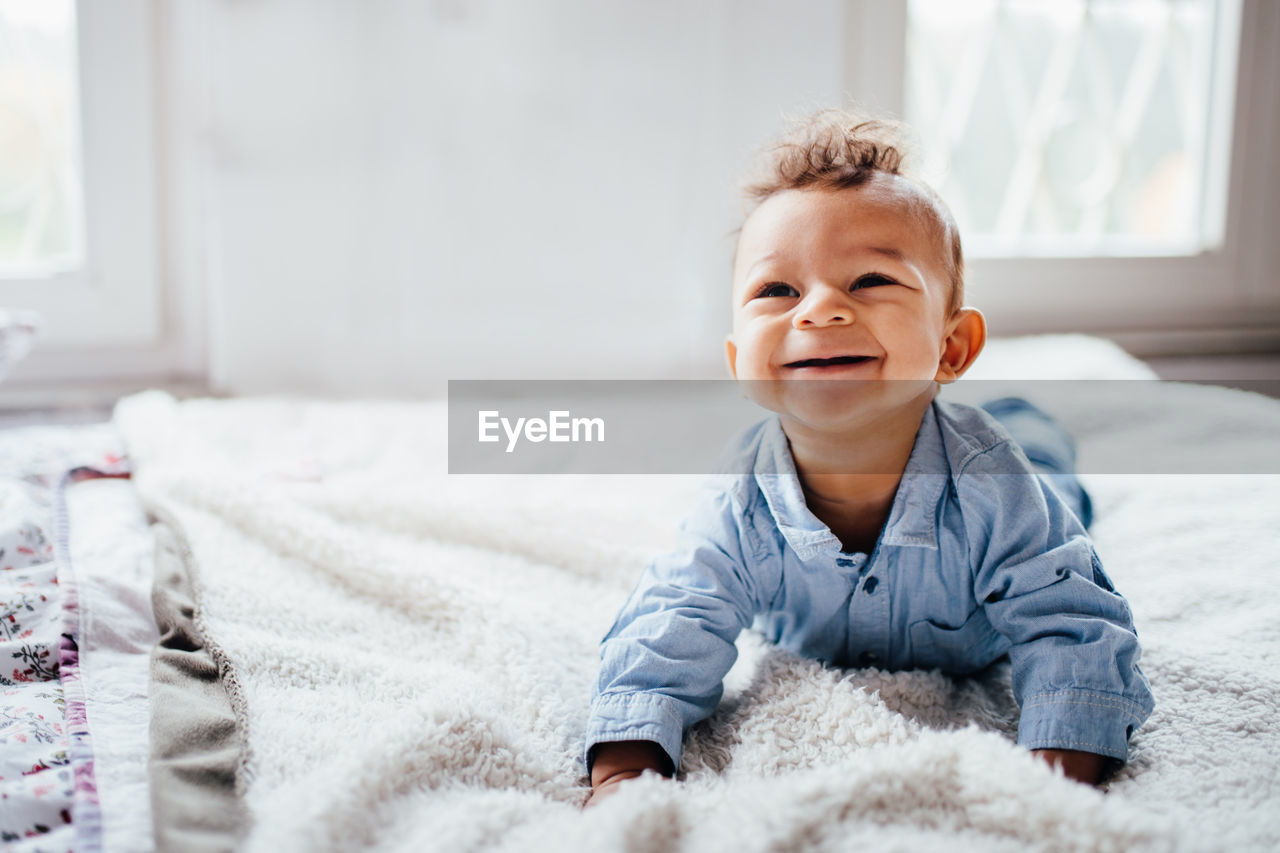 Portrait of smiling baby at home