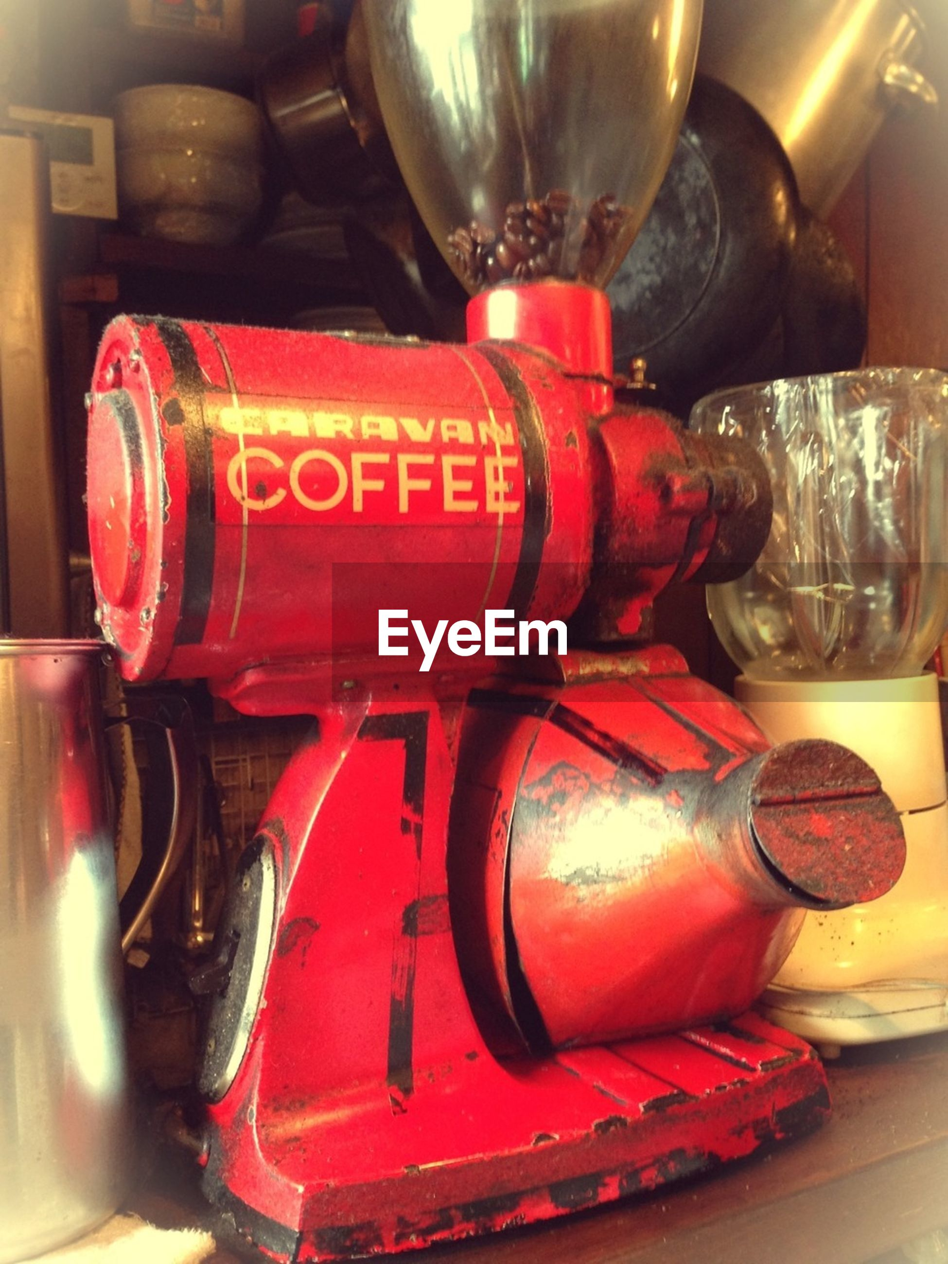 indoors, red, still life, close-up, no people, glass - material, store, old-fashioned, variation, technology, retro styled, text, transportation, shelf, in a row, choice, large group of objects, bottle, focus on foreground, container