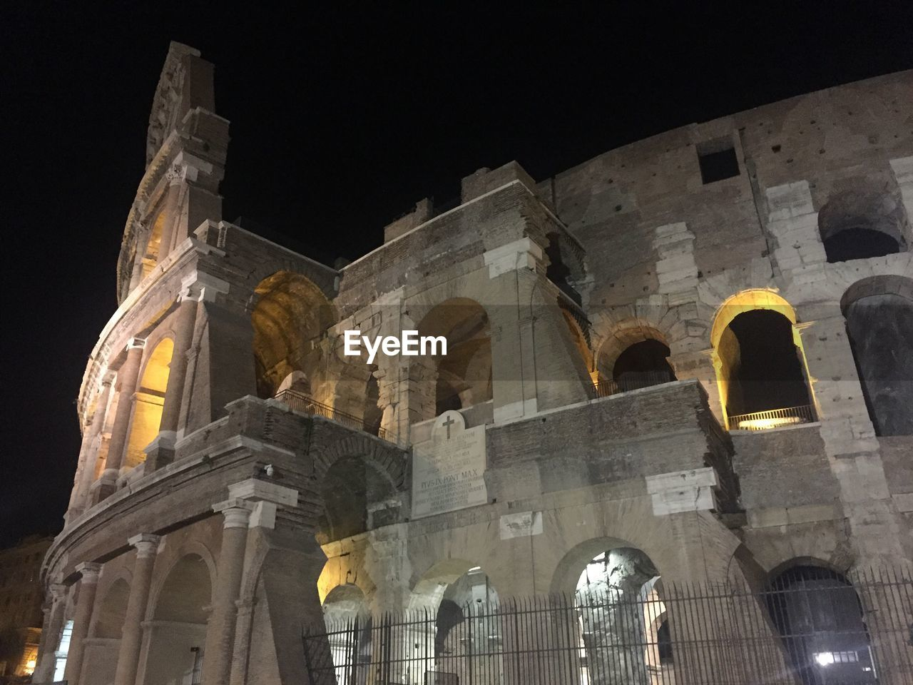 architecture, built structure, history, arch, night, low angle view, the past, old ruin, travel destinations, tourism, ancient, building exterior, ancient civilization, illuminated, travel, religion, no people, spirituality, architectural column, outdoors, place of worship, sky