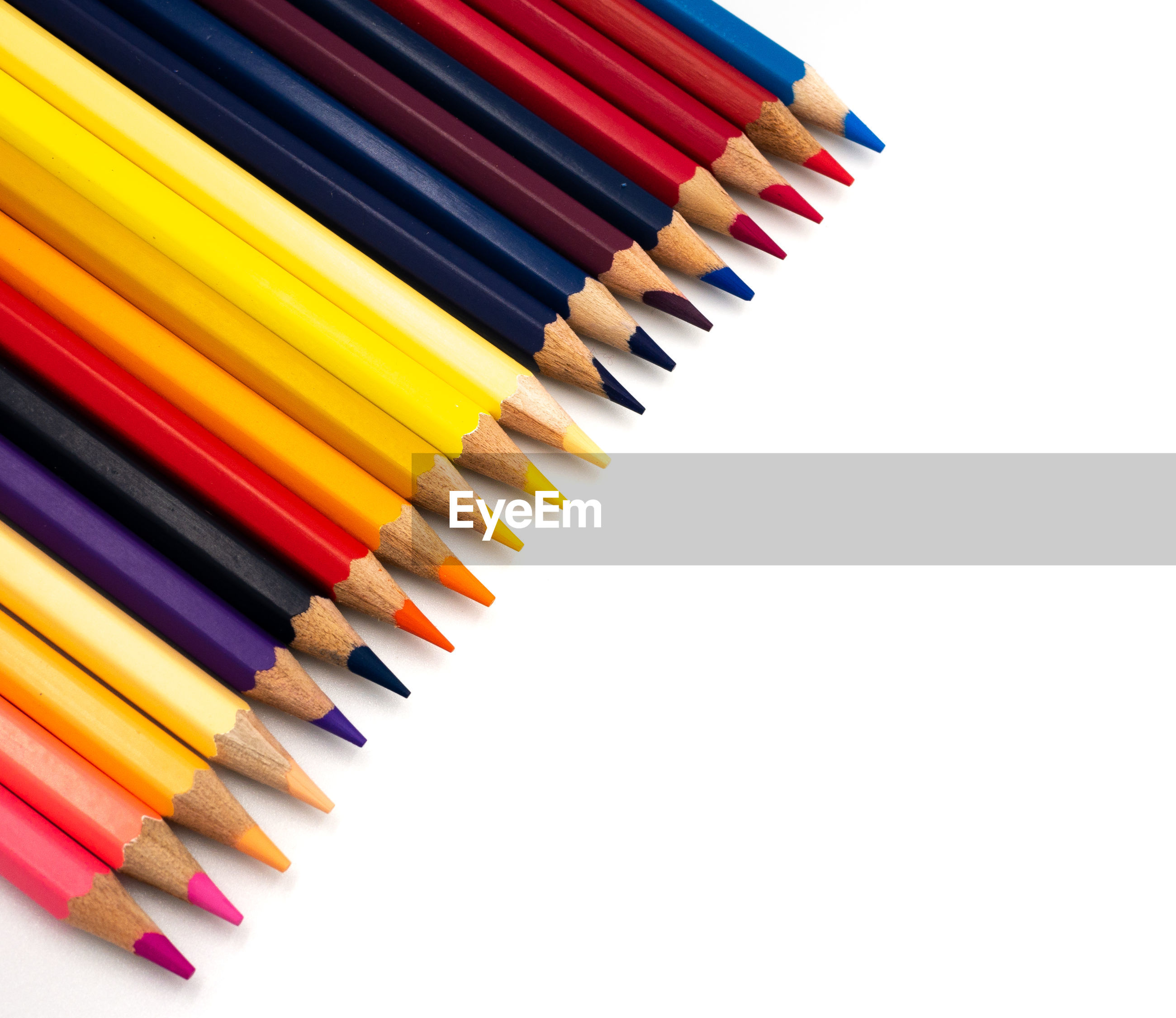 High angle view of multi colored pencils against white background