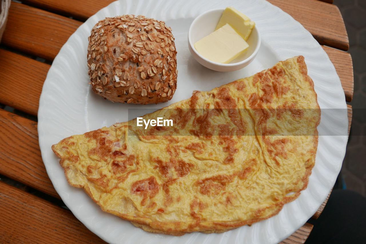 High Angle View Of Omelet Served In Plate On Table