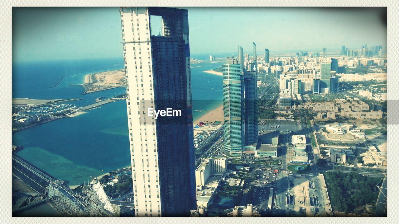 Modern Cityscape By Sea Against Sky