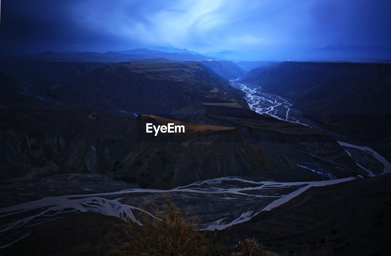 Scenic View Of River Amidst Canyon Against Sky