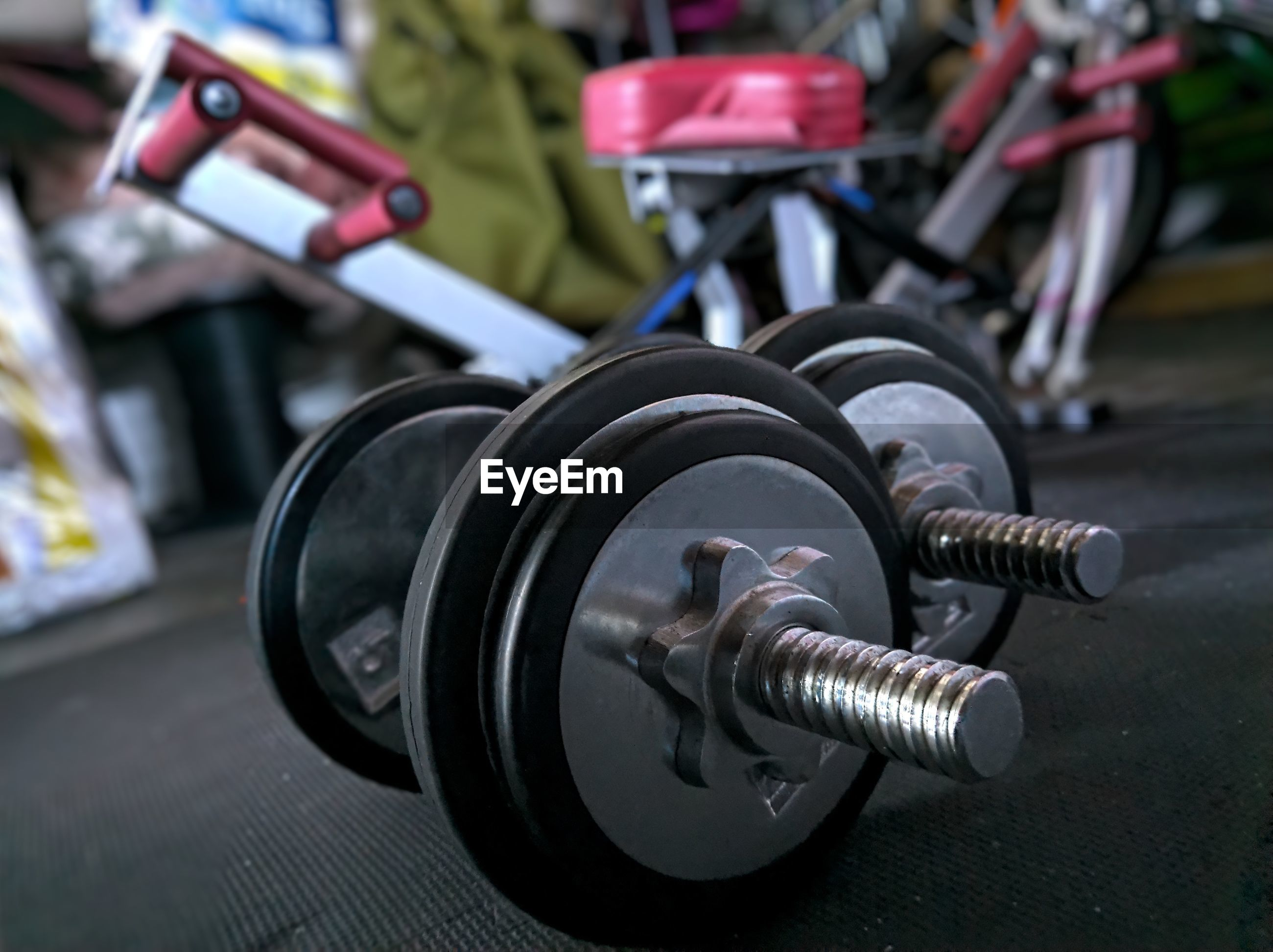 Close-up of dumbbell on floor