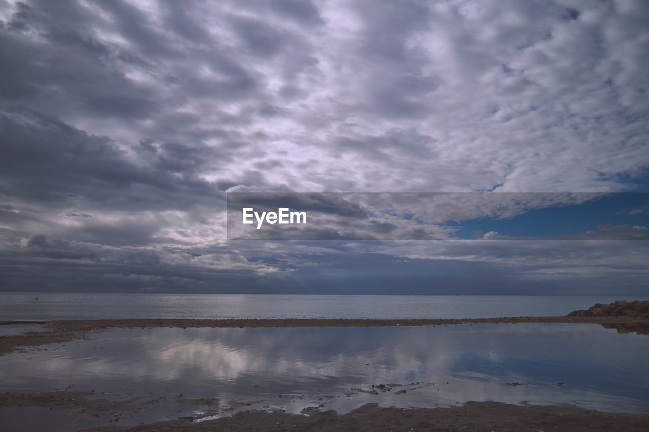cloud - sky, sky, water, tranquility, scenics - nature, beauty in nature, tranquil scene, sea, nature, non-urban scene, no people, idyllic, reflection, day, outdoors, overcast, horizon, beach