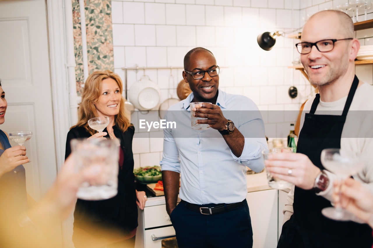 men, males, real people, glasses, mid adult, indoors, adult, refreshment, young adult, drink, food and drink, eyeglasses, mid adult men, smiling, alcohol, holding, front view, communication, togetherness, glass