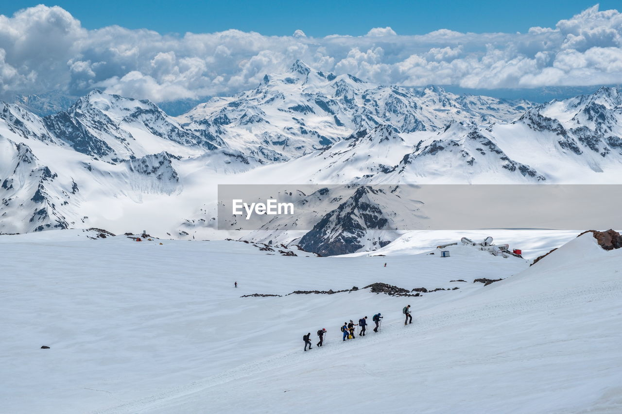 Group of people on snow covered mountain