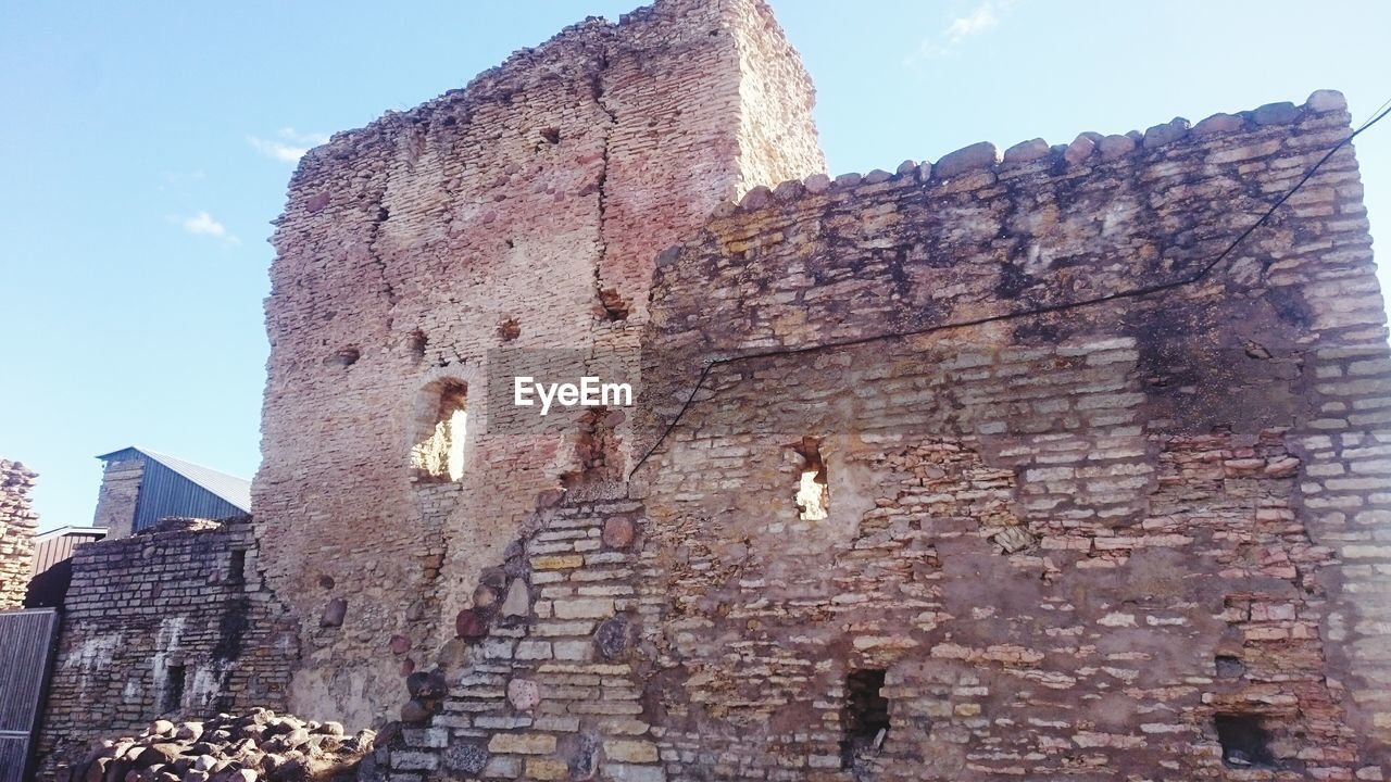 architecture, built structure, low angle view, history, building exterior, day, old ruin, no people, outdoors, travel destinations, sky, ancient civilization