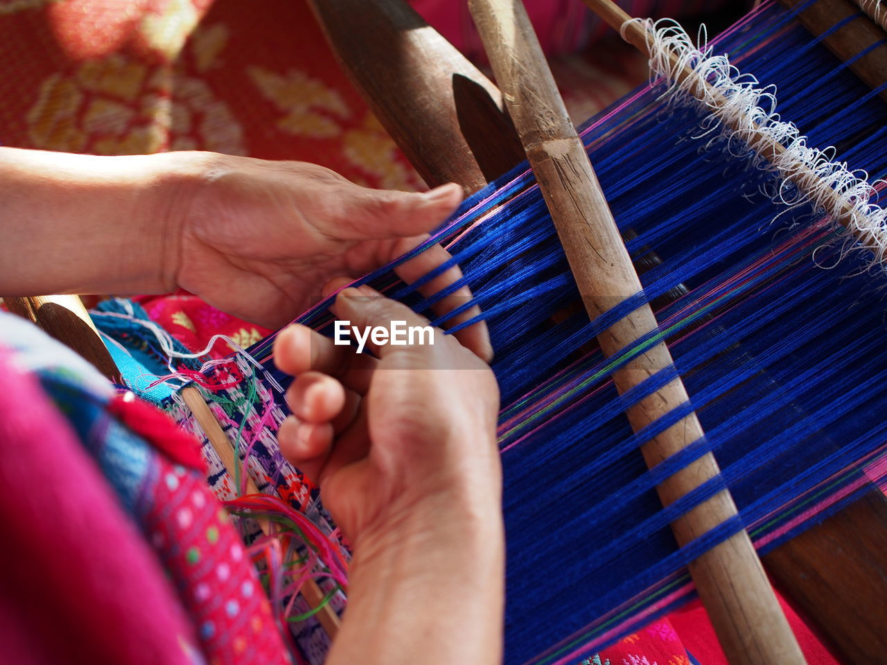 art and craft, textile, craft, thread, skill, weaving, working, loom, industry, indoors, real people, human hand, wool, hand, one person, selective focus, creativity, human body part, occupation, holding