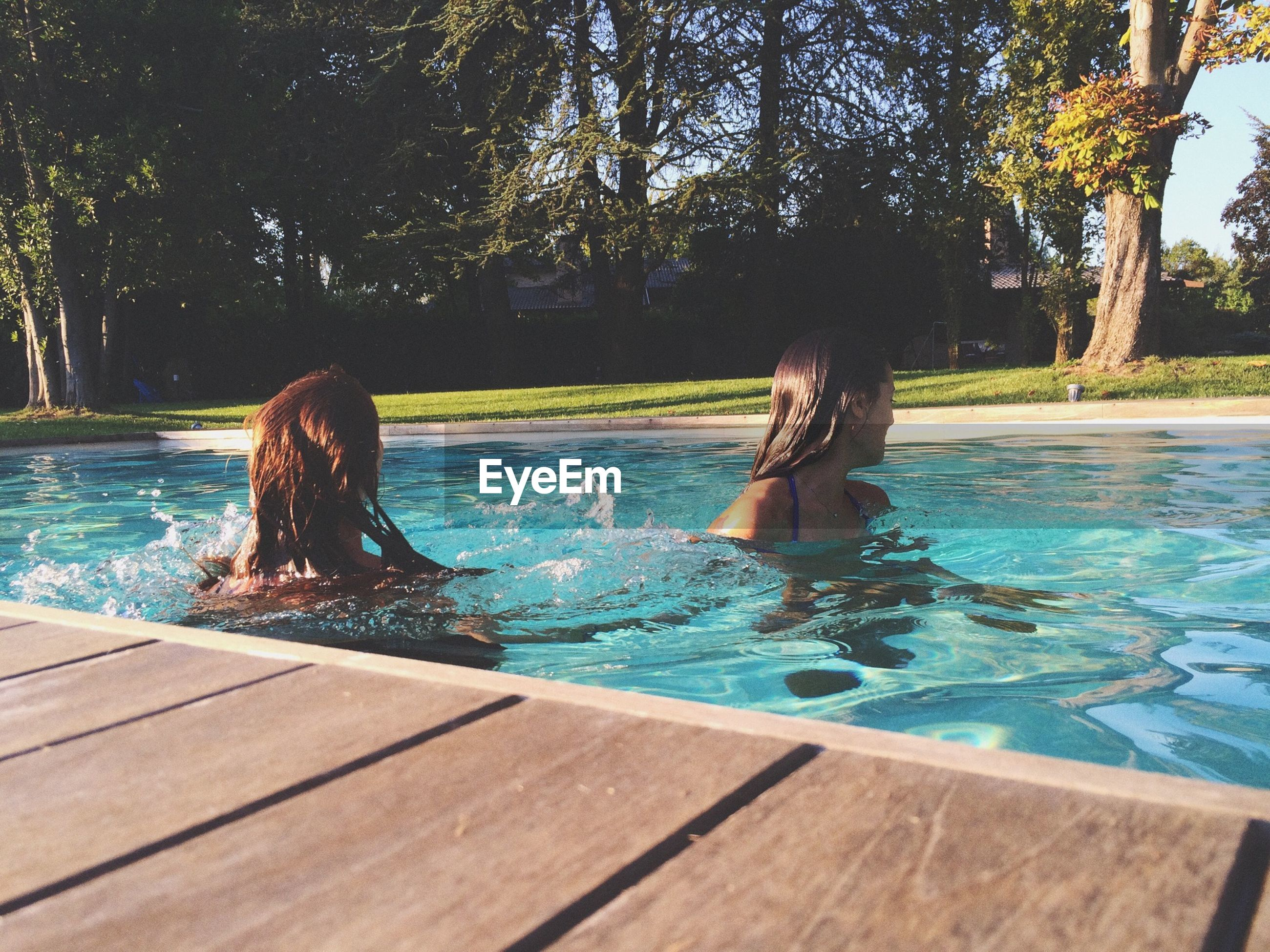 water, tree, swimming pool, nature, tranquility, sunlight, day, wood - material, beauty in nature, lake, splashing, rippled, motion, outdoors, leisure activity, tranquil scene, scenics, relaxation