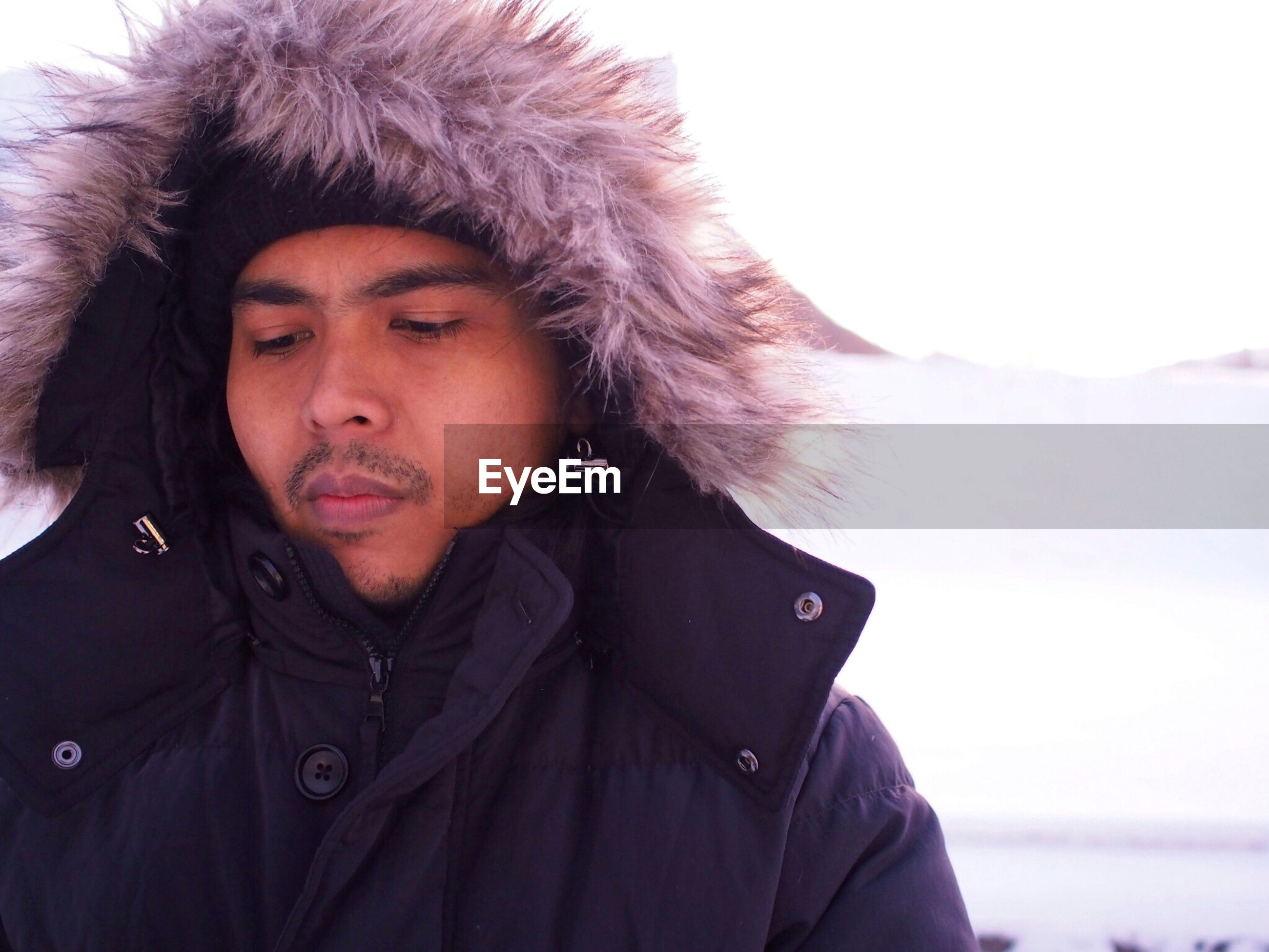 Close-up of man against snow covered landscape