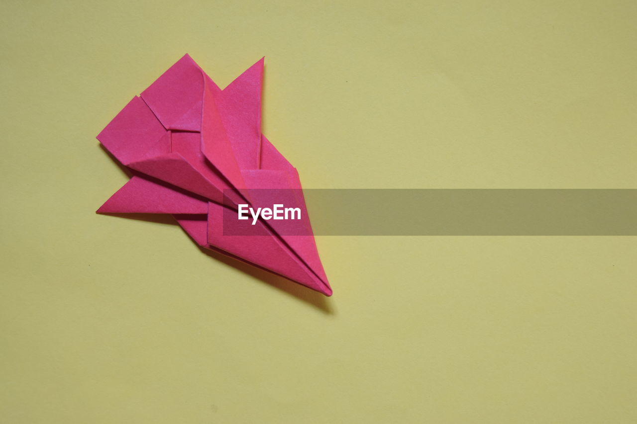 art and craft, paper, craft, creativity, indoors, studio shot, no people, close-up, copy space, still life, colored background, origami, pink color, craft product, yellow, wall - building feature, representation, paper boat, single object