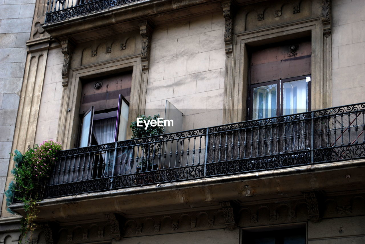 HOUSES SEEN THROUGH BALCONY WINDOW