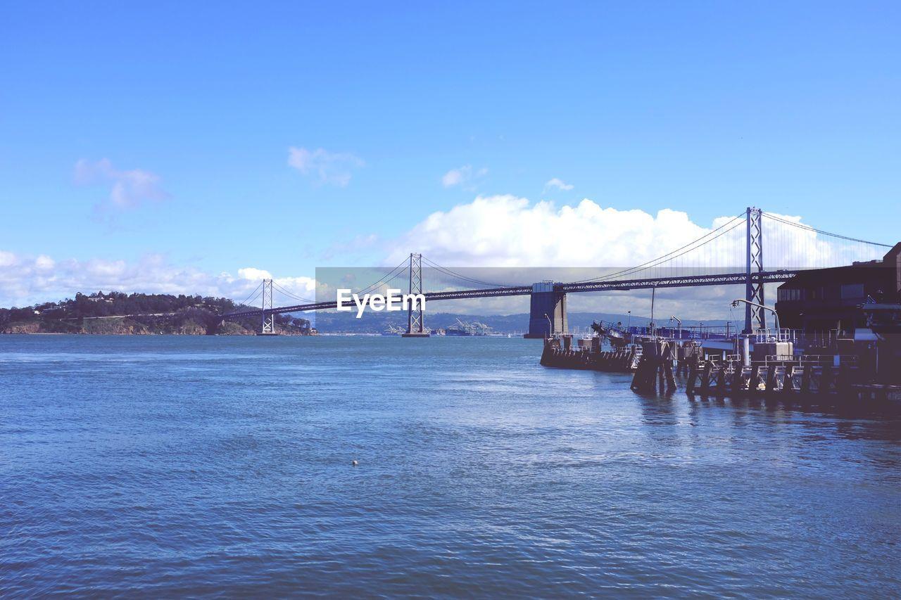 San franciscooakland bay bridge over sea against sky