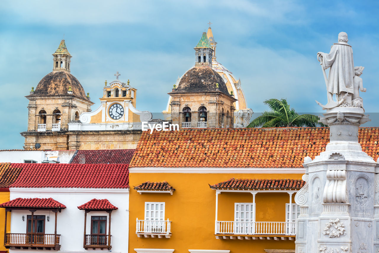 Low Angle View Of Statues With Iglesia De San Pedro Claver Against Sky