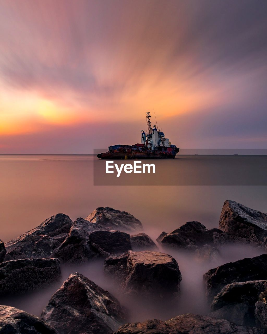 sky, water, sea, sunset, scenics - nature, beauty in nature, rock, rock - object, cloud - sky, solid, nature, nautical vessel, horizon over water, no people, tranquil scene, tranquility, transportation, mode of transportation, offshore platform, outdoors