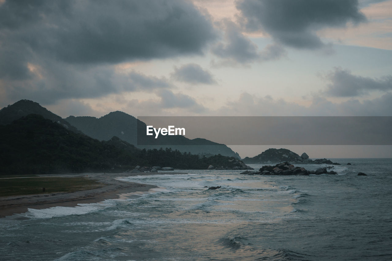 sky, sea, water, beauty in nature, cloud - sky, mountain, scenics - nature, tranquility, land, tranquil scene, beach, no people, nature, non-urban scene, wave, outdoors, idyllic, day