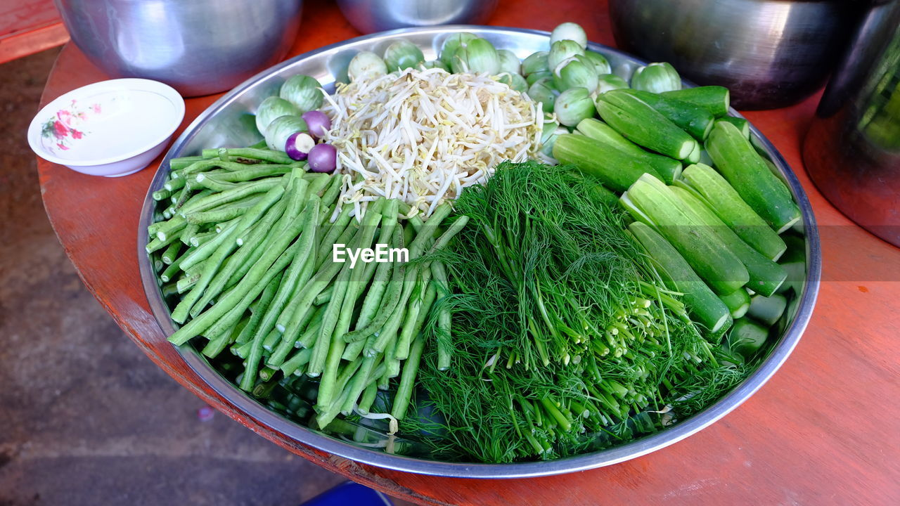 food, food and drink, vegetable, healthy eating, freshness, wellbeing, still life, green color, high angle view, table, indoors, no people, bowl, close-up, raw food, green bean, container, large group of objects, ready-to-eat, onion, chopped