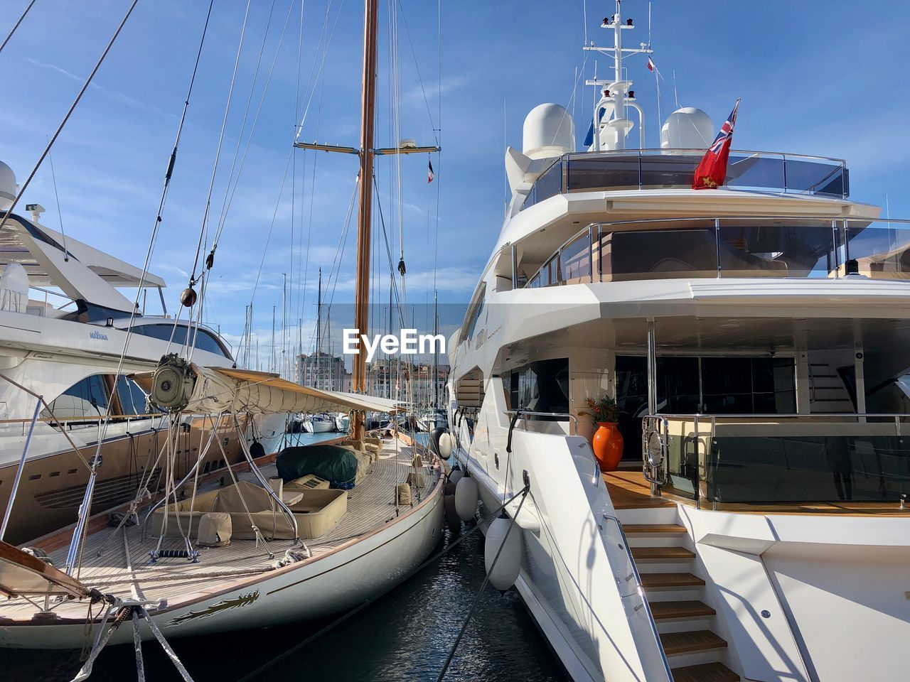 nautical vessel, mode of transportation, transportation, water, moored, sky, sea, sailboat, nature, day, mast, pole, ship, travel, no people, sailing, harbor, architecture, rope, outdoors, luxury, yacht, cruise ship