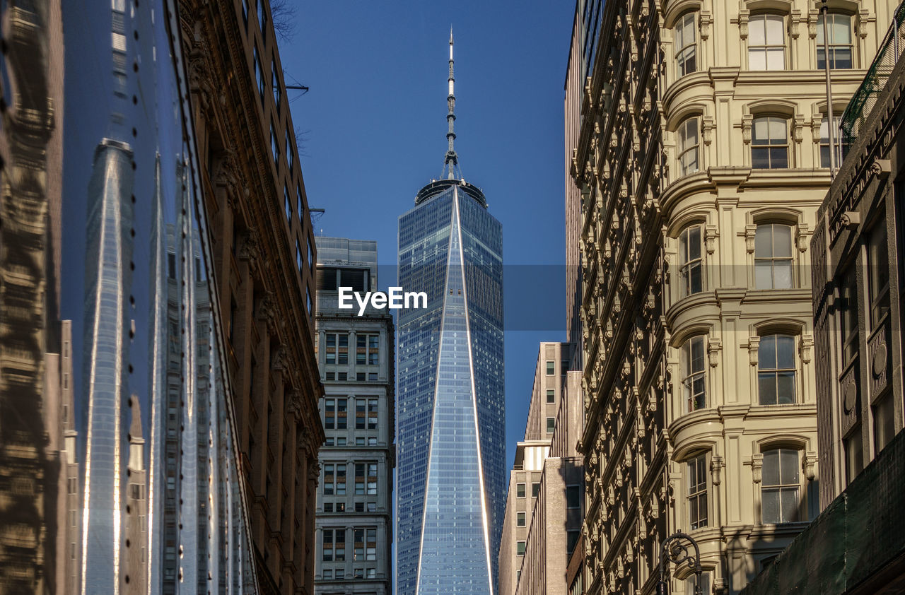 built structure, architecture, building exterior, building, city, tall - high, tower, sky, day, nature, no people, travel destinations, travel, office building exterior, clear sky, skyscraper, low angle view, outdoors, tourism, modern, spire, financial district