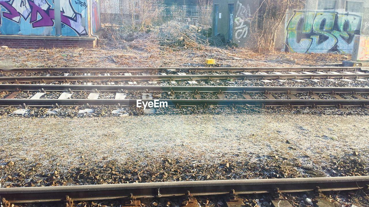 railroad track, rail transportation, text, no people, day, transportation, communication, outdoors