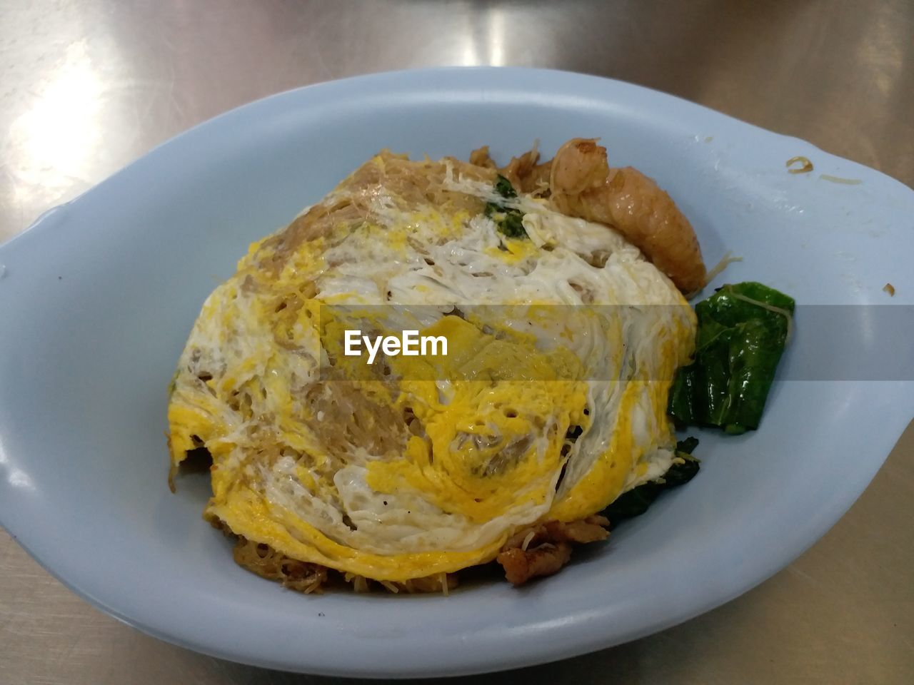 plate, food and drink, food, ready-to-eat, freshness, healthy eating, wellbeing, table, indoors, close-up, egg, serving size, still life, meal, high angle view, no people, yellow, breakfast, indulgence, meat, egg yolk, fried egg, temptation, dinner, snack, crockery