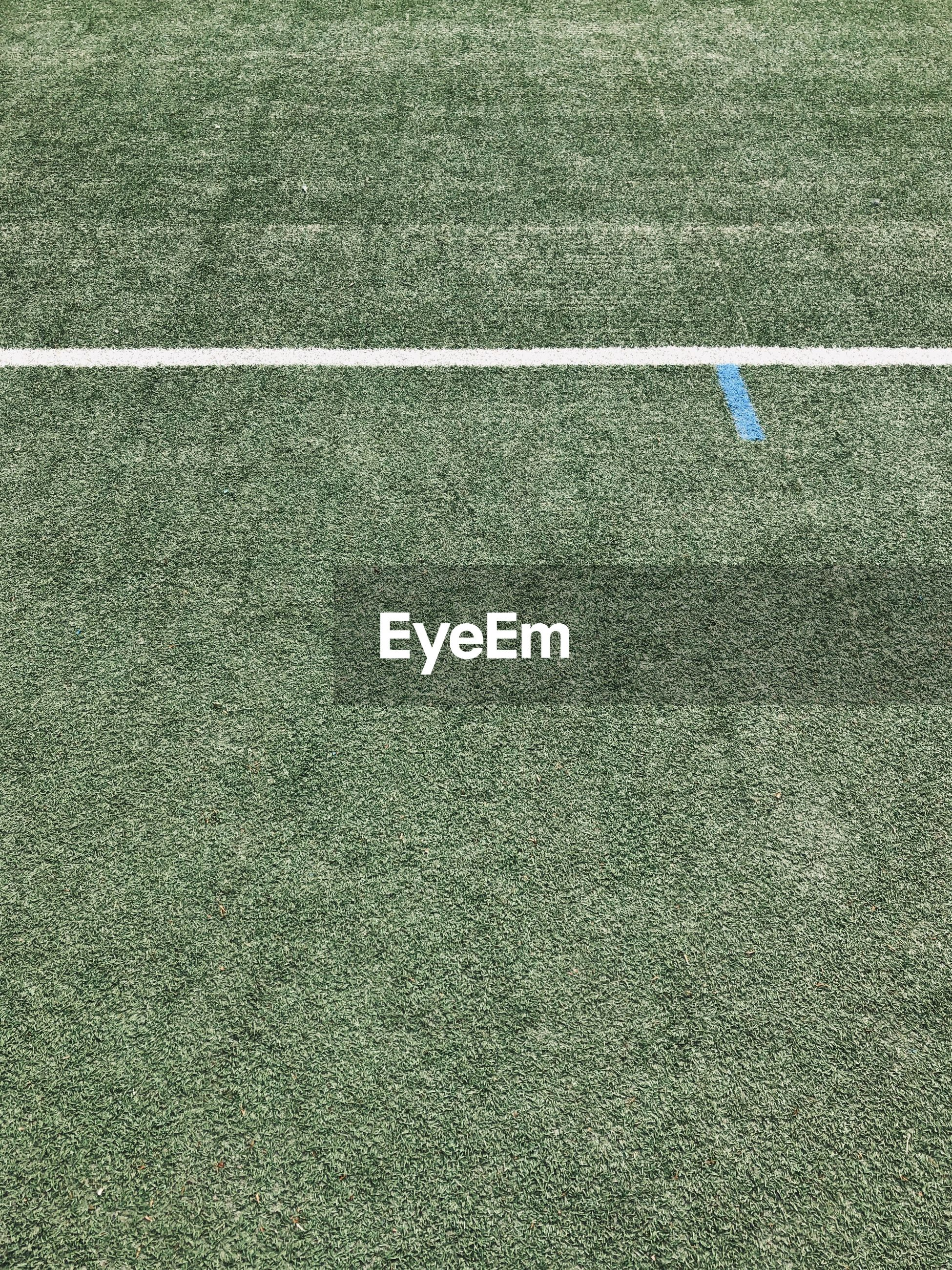 HIGH ANGLE VIEW OF SOCCER FIELD AND SHADOW ON THE GROUND