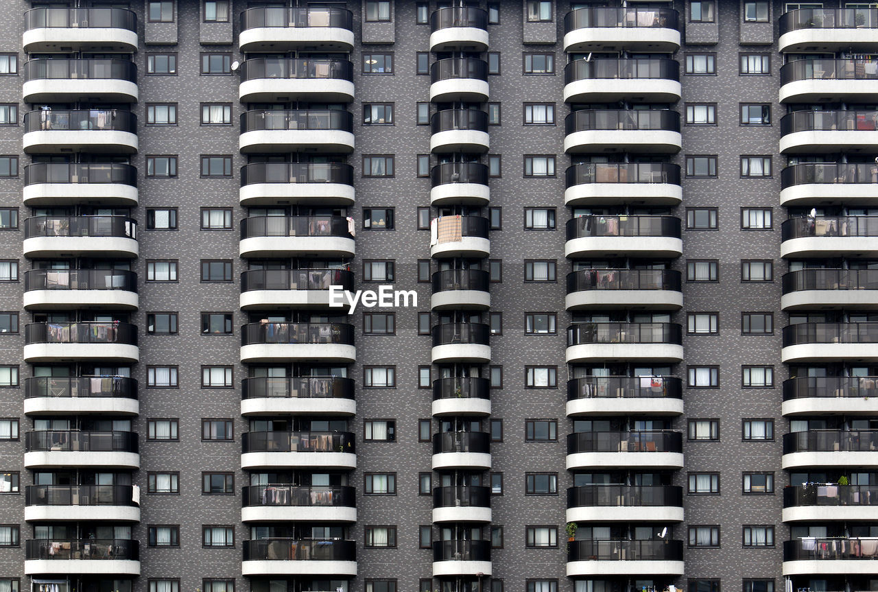 apartment, architecture, residential building, housing development, window, home ownership, city, building exterior, built structure, conformity, full frame, balcony, community, house, social issues, day, skyscraper, housing project, modern, backgrounds, no people, outdoors, residential
