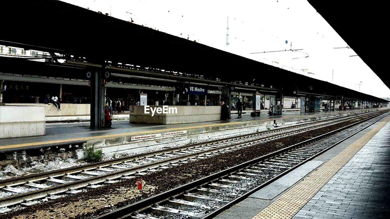 rail transportation, transportation, railroad track, railroad station platform, railroad station, public transportation, day, no people, outdoors, sky