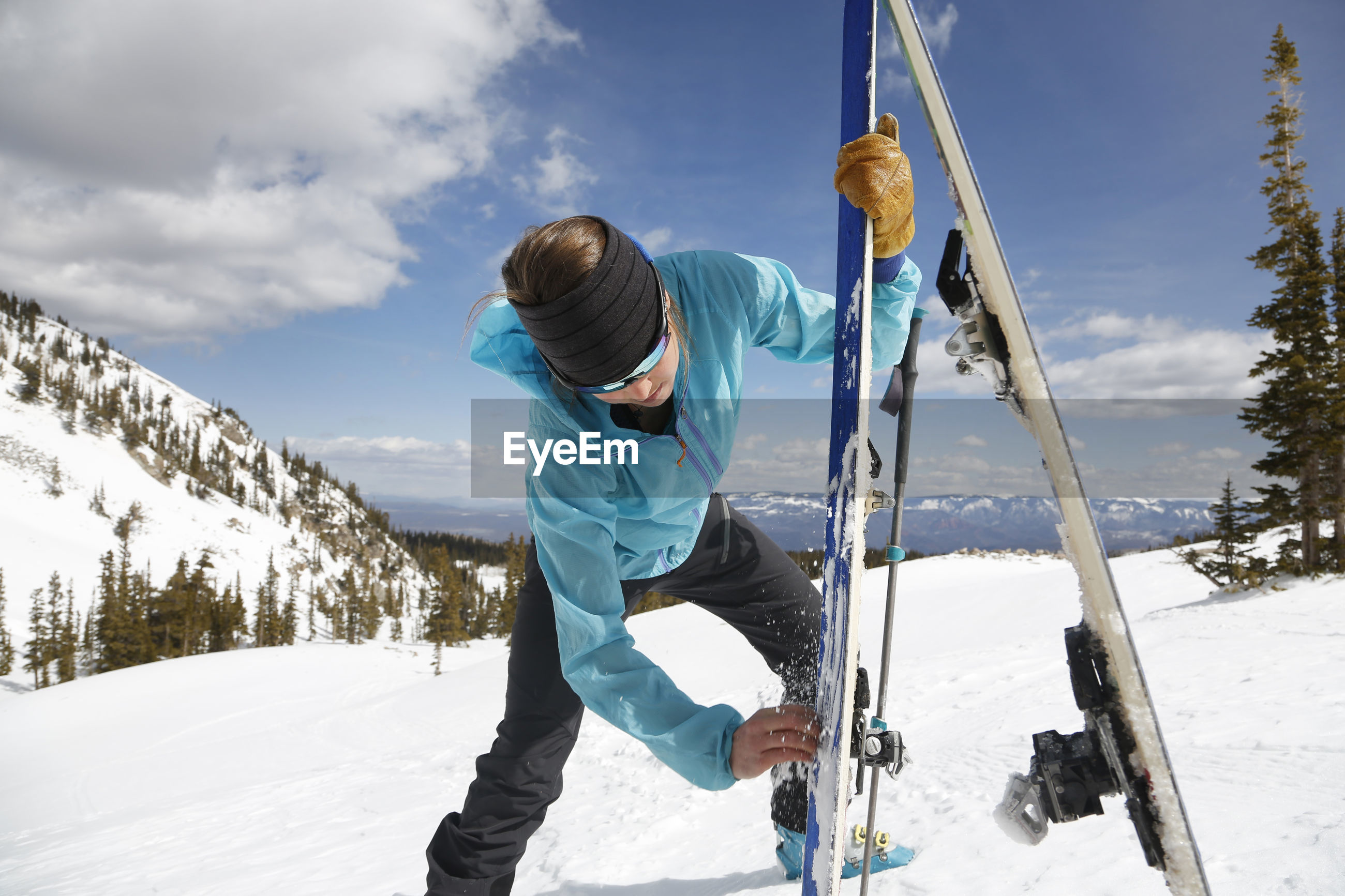 FULL LENGTH OF MAN ON SNOW COVERED MOUNTAIN