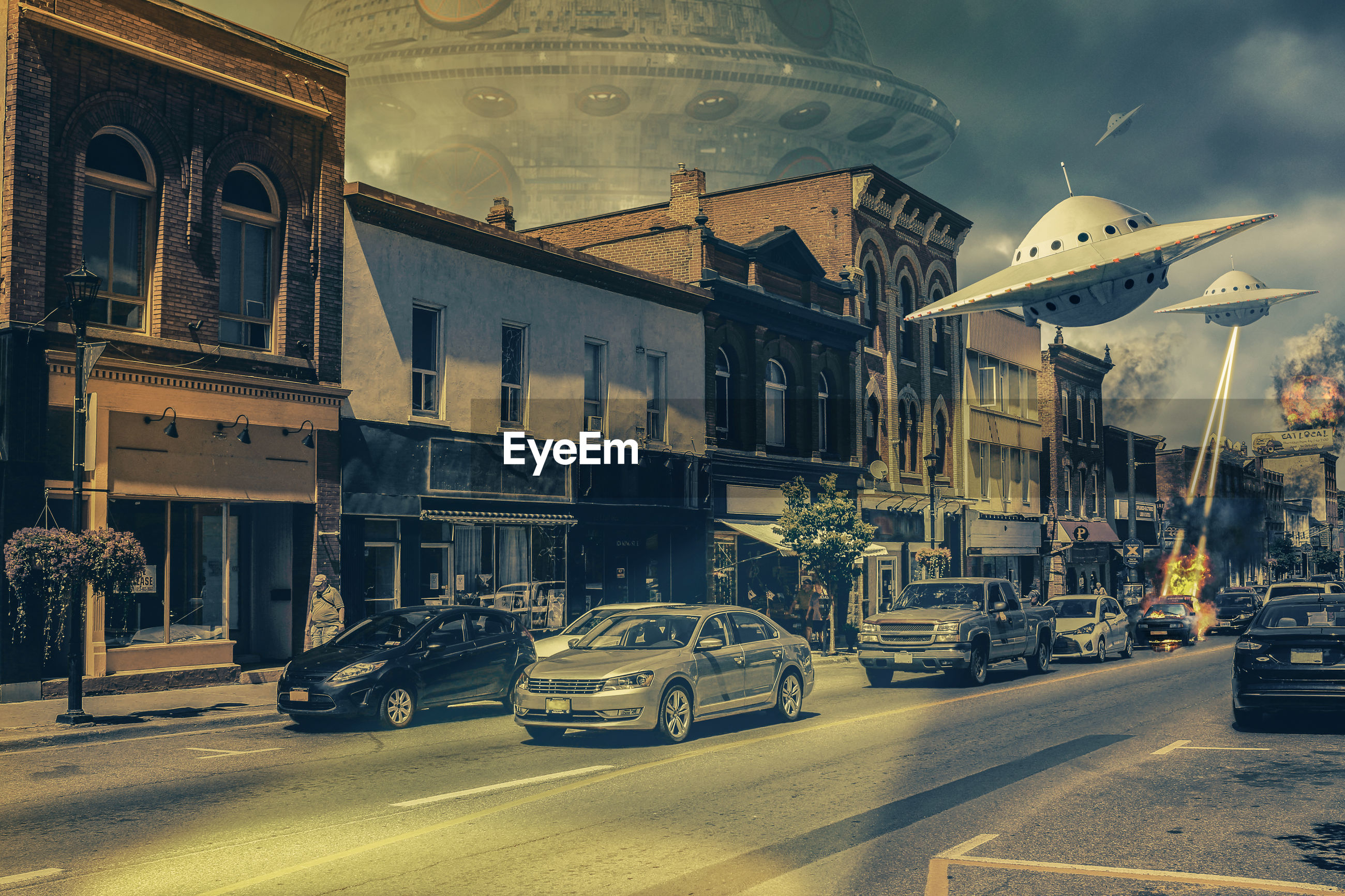 Digital composite image of ufo attacking buildings and cars on in city