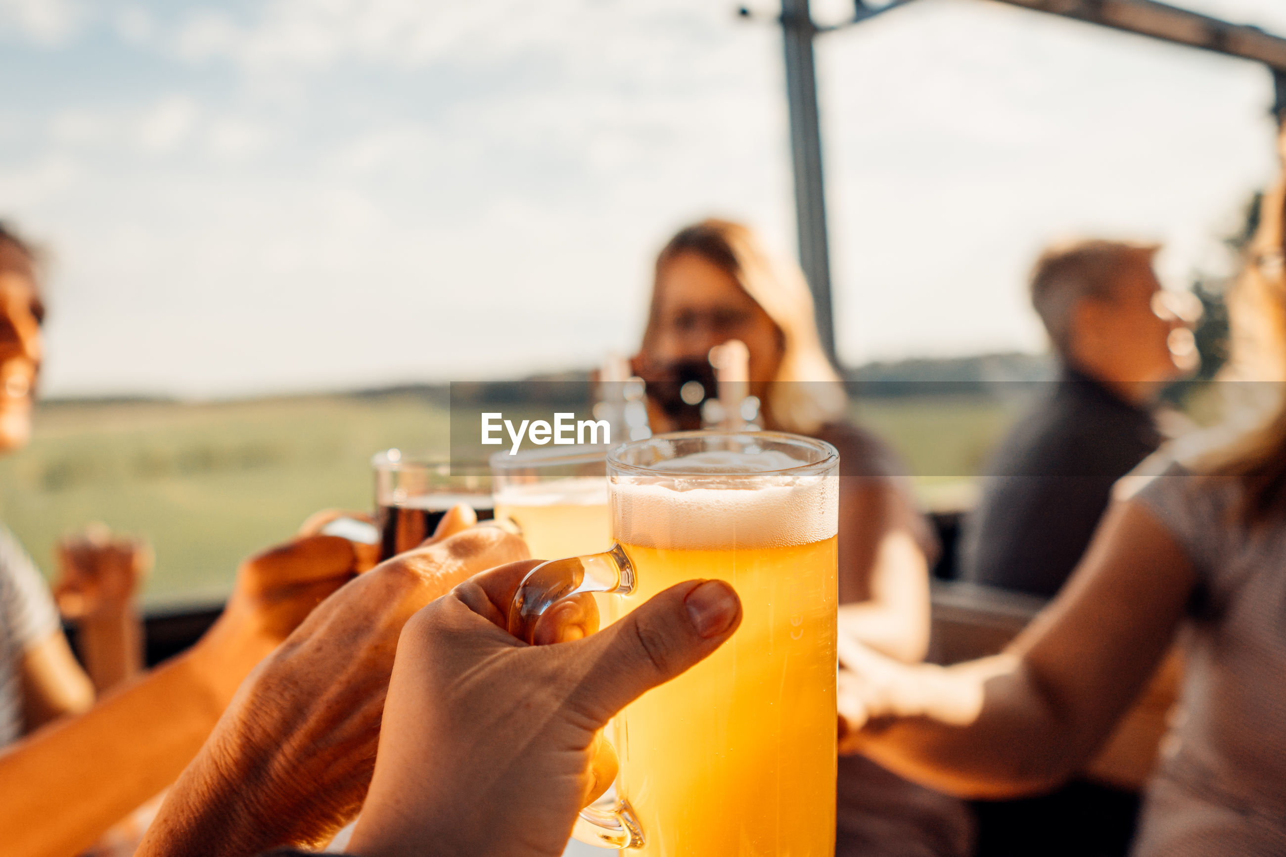 MIDSECTION OF PEOPLE DRINKING GLASS