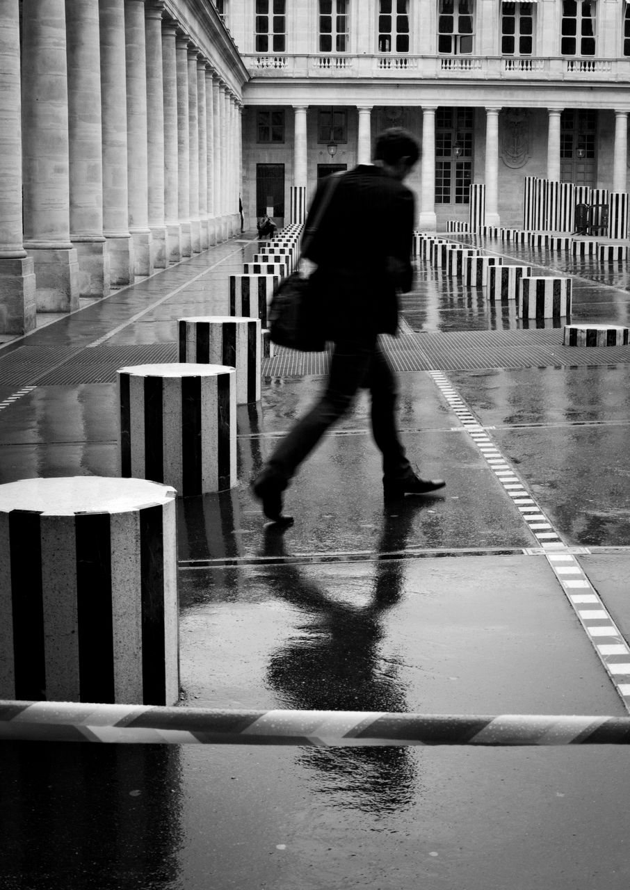 Man Walking On Wet Footpath Comedie-Francaise