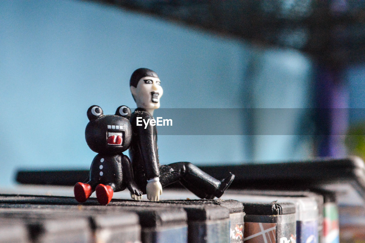 human representation, toy, representation, no people, male likeness, focus on foreground, table, still life, indoors, creativity, selective focus, close-up, figurine, technology, art and craft, black color, fun, futuristic, plastic, craft