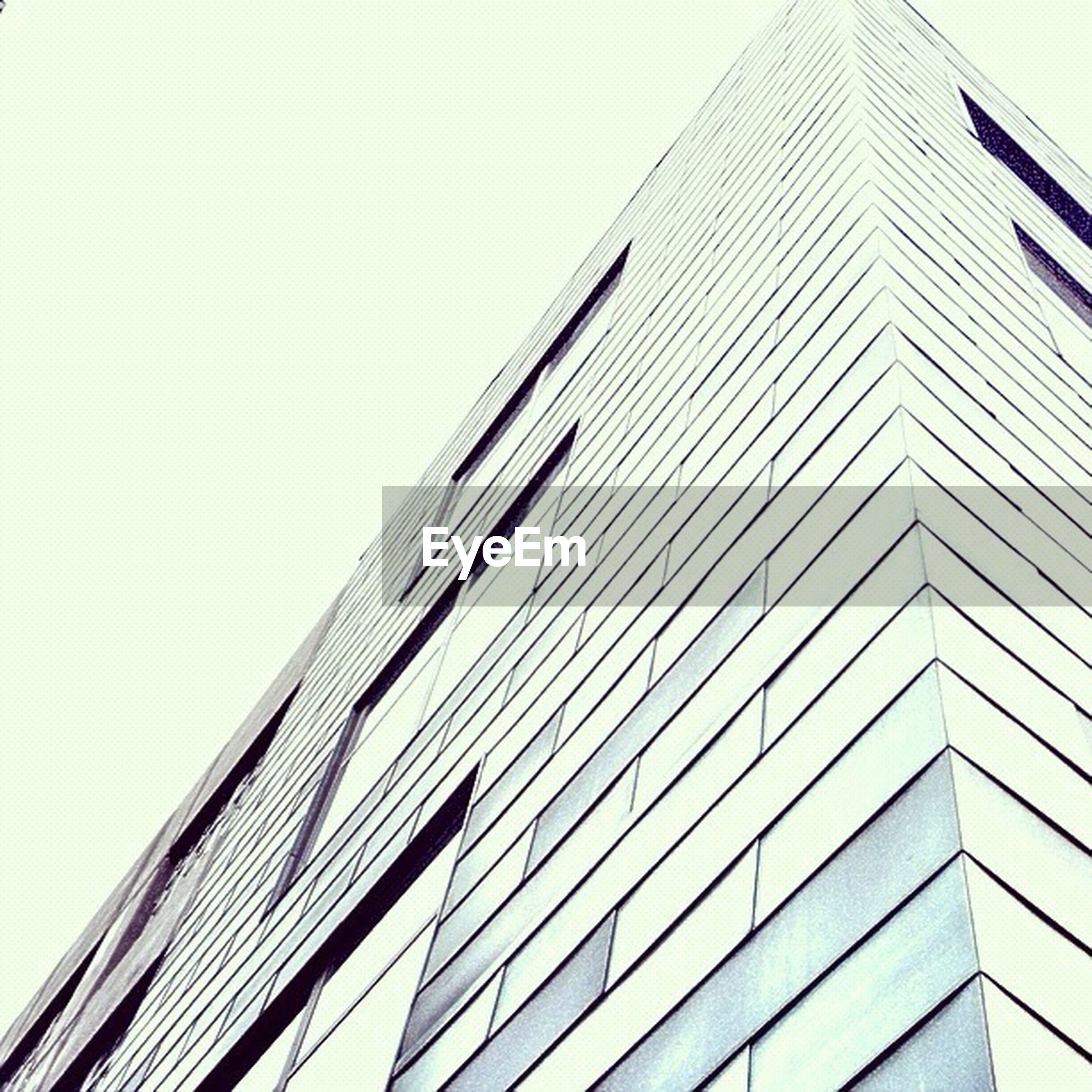 building exterior, architecture, built structure, low angle view, modern, office building, skyscraper, tall - high, clear sky, city, tower, building, window, day, glass - material, outdoors, tall, no people, sky, reflection