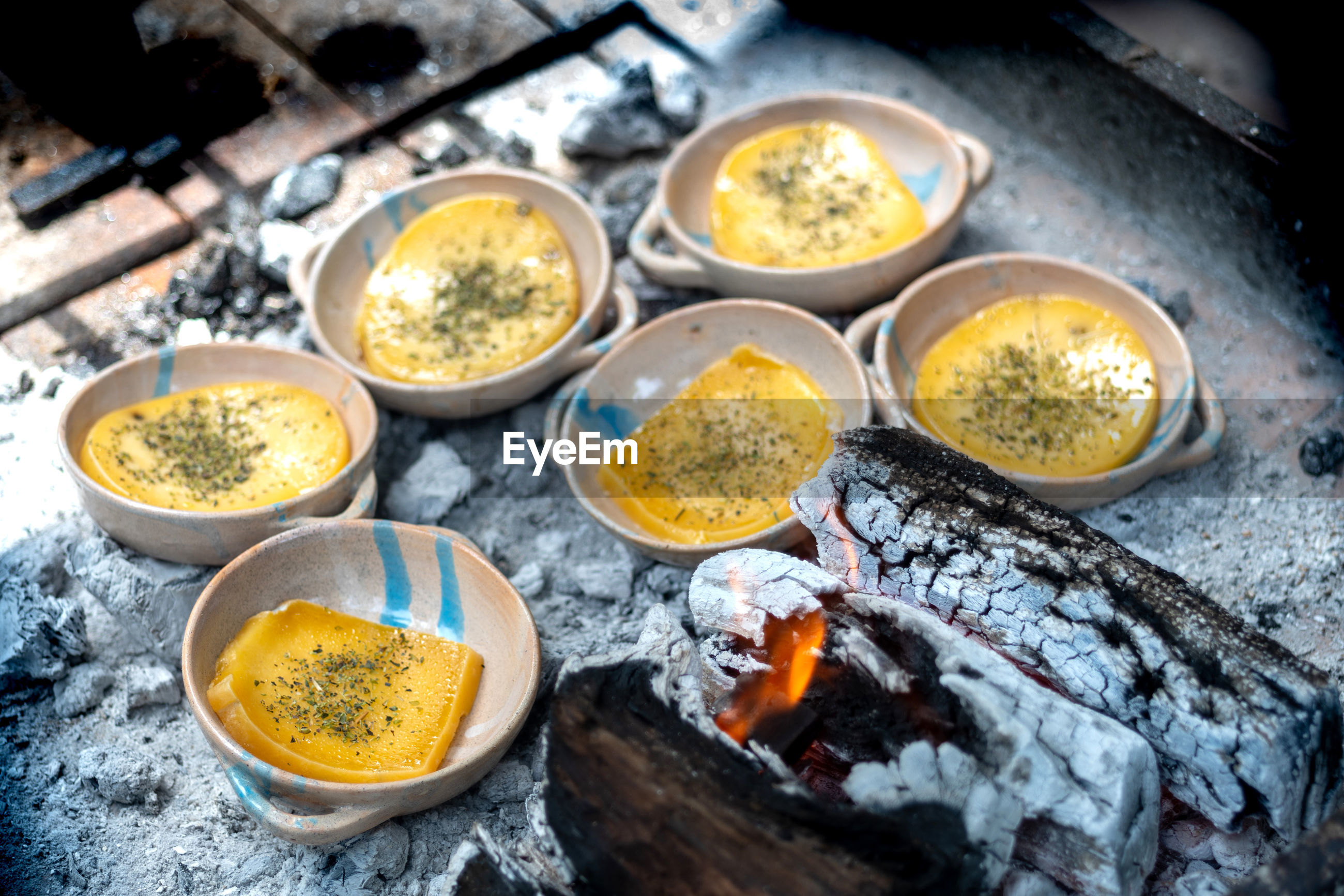 High angle view of food provoleta cheese cooking over the fire