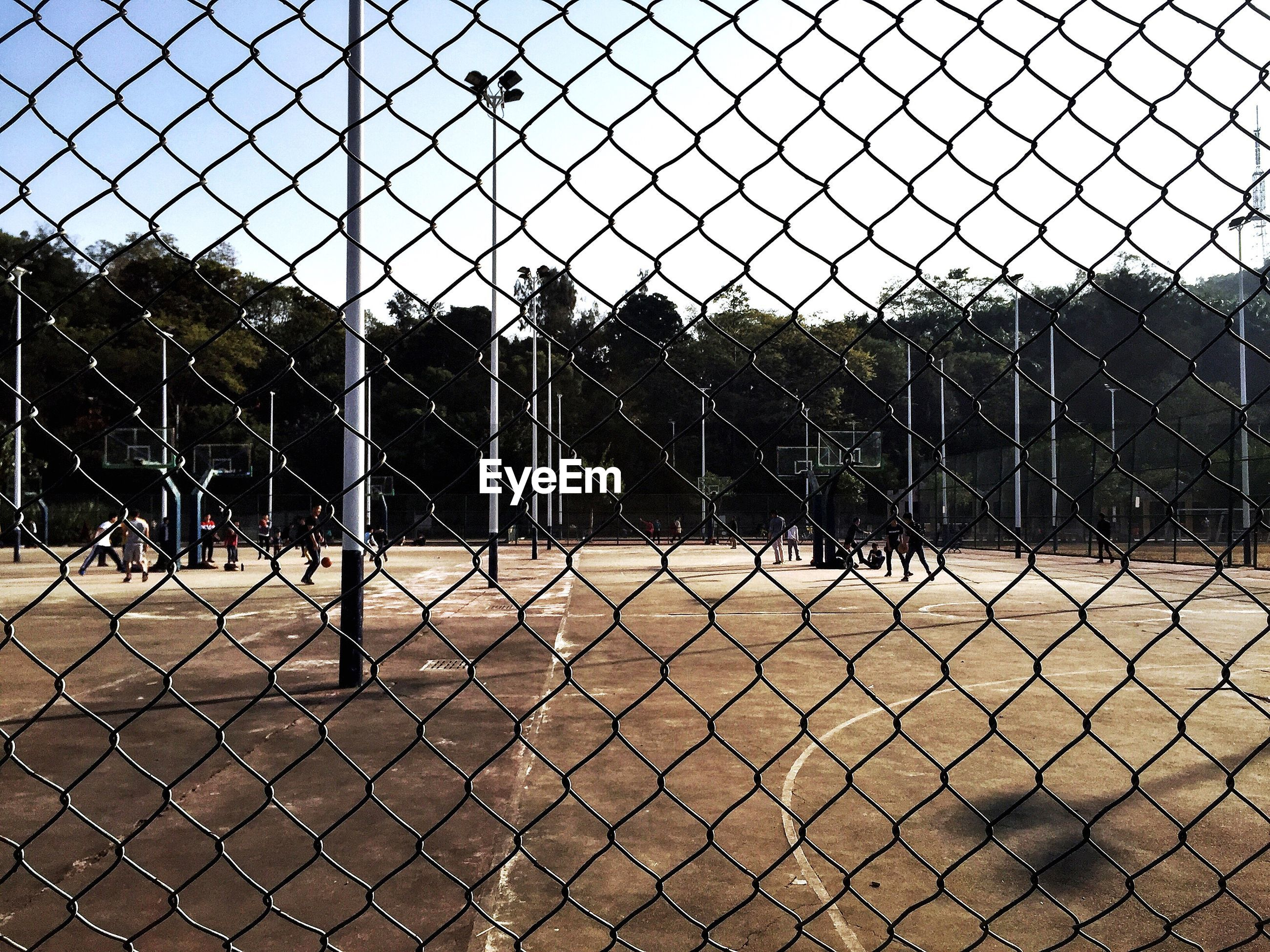 fence, chainlink fence, protection, safety, security, metal, wire mesh, no people, outdoors, day, baseball - sport, sky, close-up