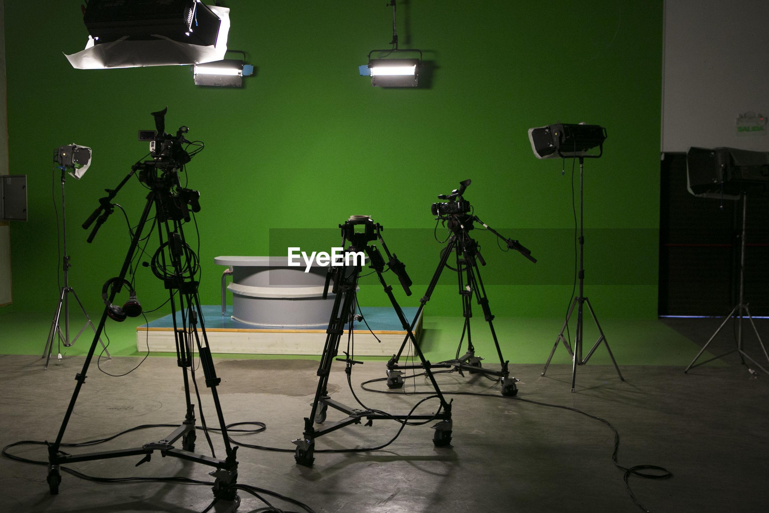 Camera on tripods in film studio
