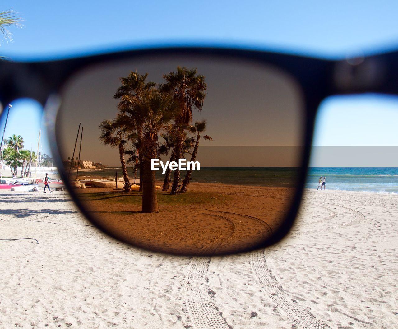 Palm Trees At Beach Seen Through Sunglasses