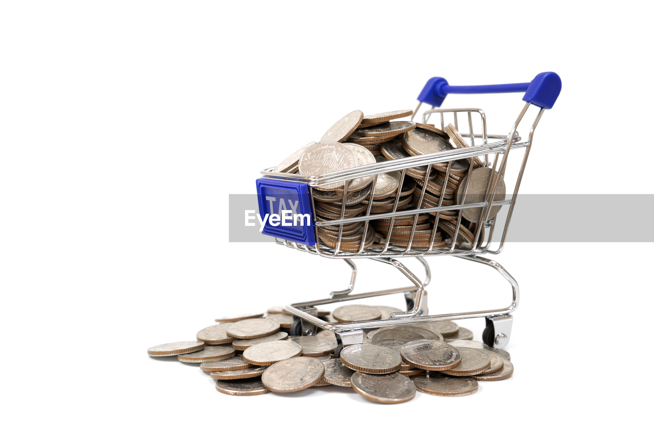 Toy shopping cart with coins and tax text on white background