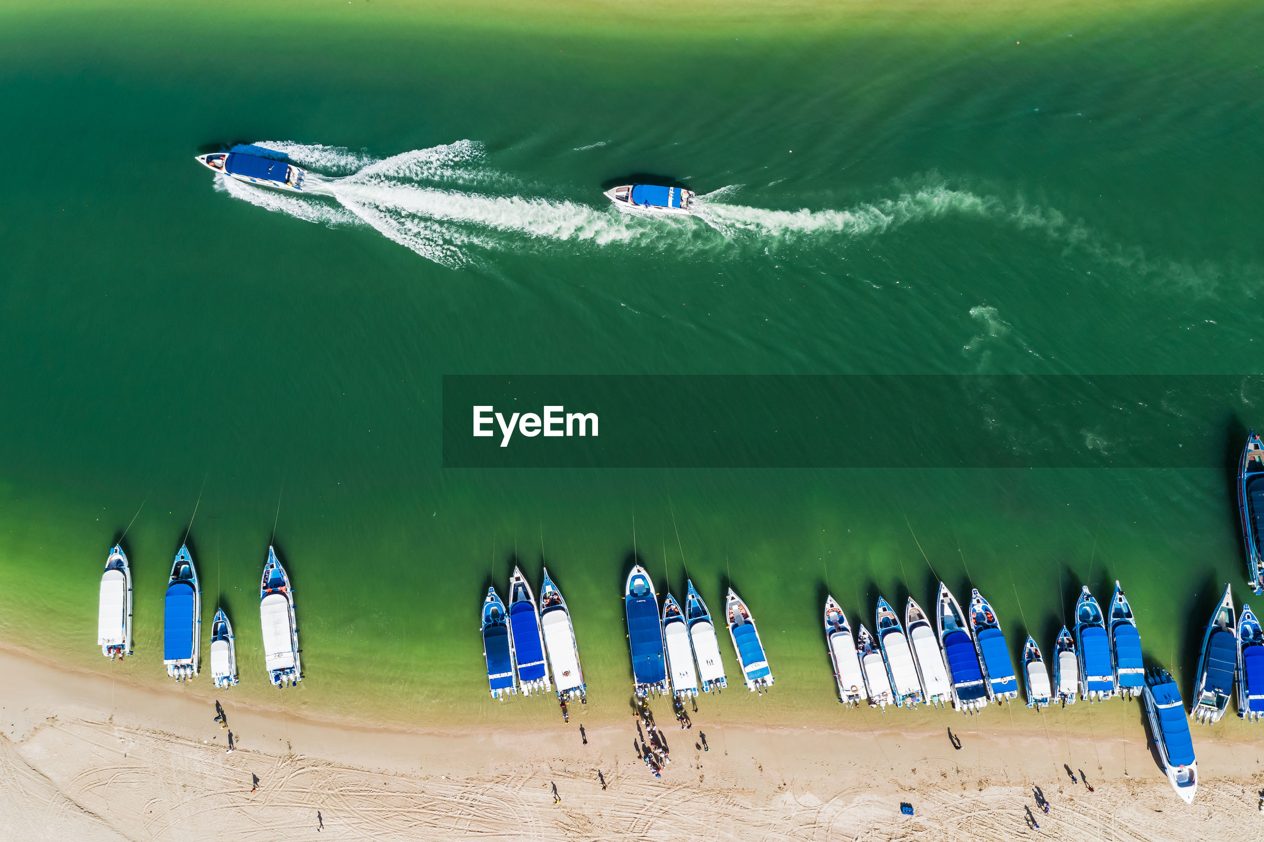 High angle view of speed boat passenger on the beach and sailing on the sea pang nga thailand