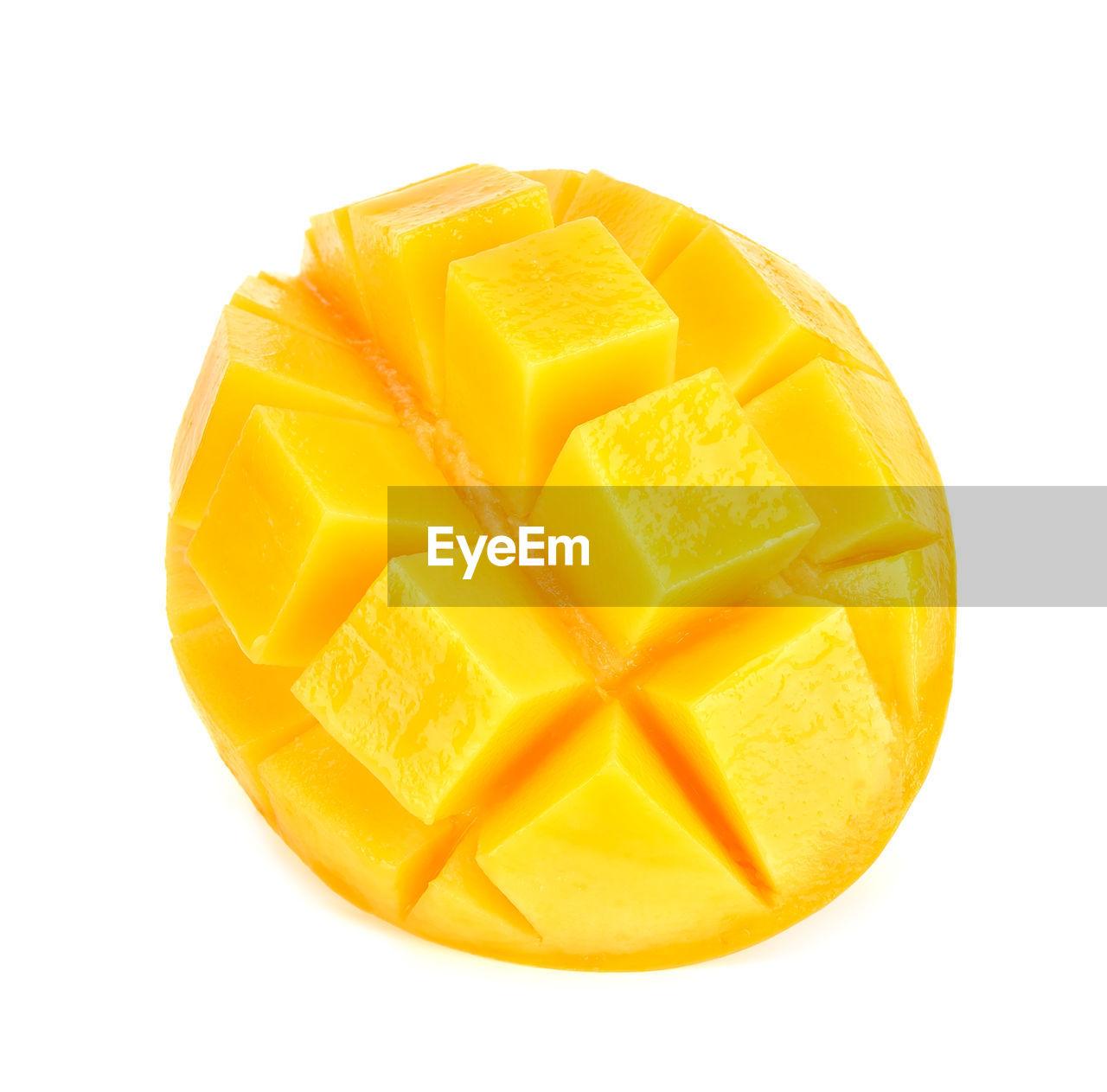 Close-up of mango against white background